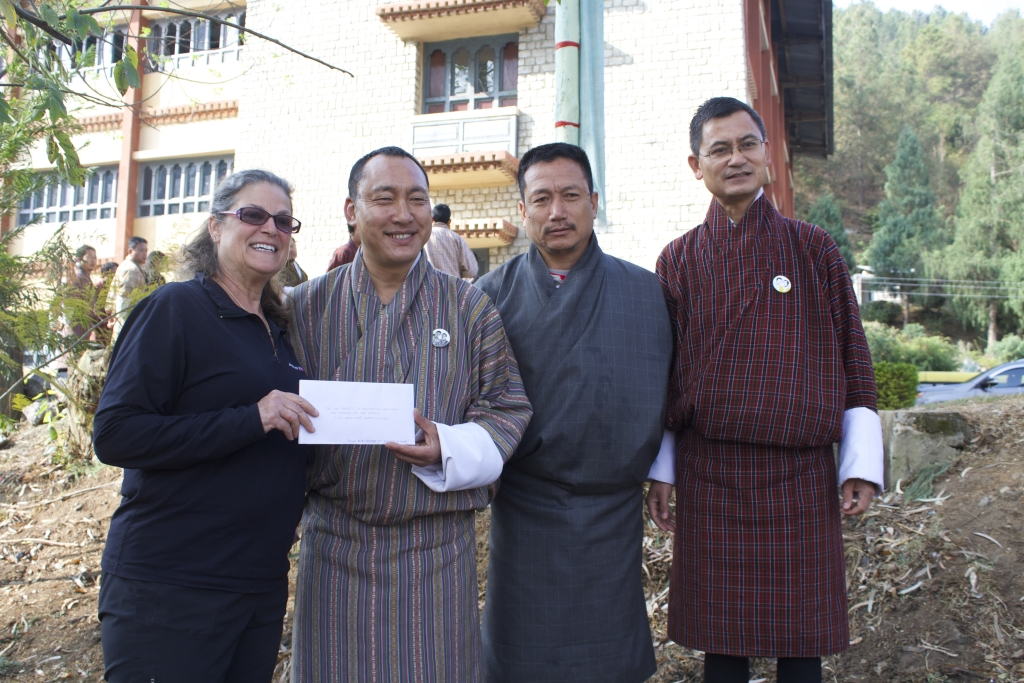 Rooted In Hope makes a donation to support Bhutan's tree-planting efforts.